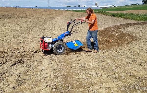 Mike Plowing A Contour Swale